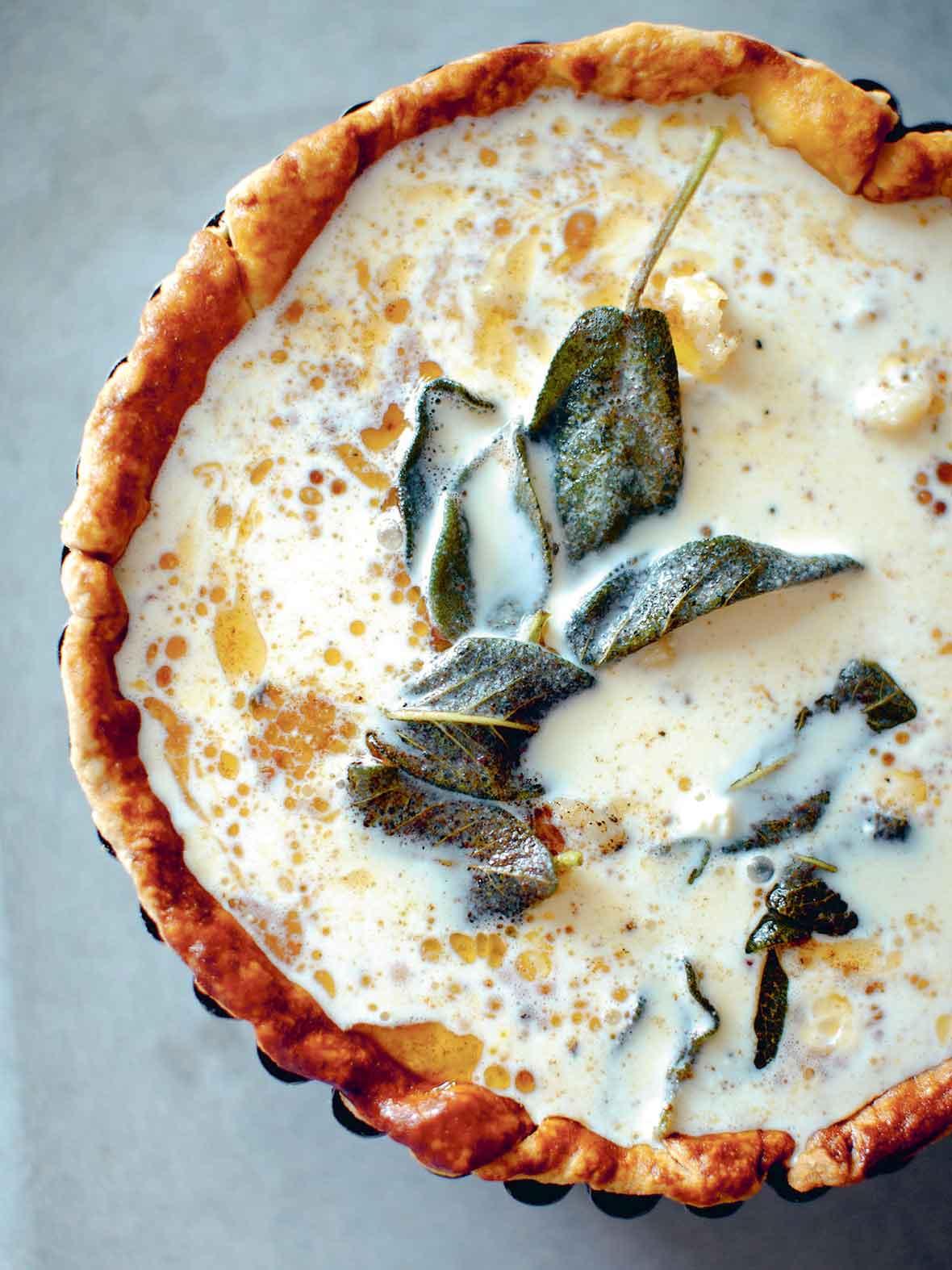An uncooked butternut squash quiche.
