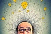 A questioning man with illustrations of lightbulb swirling above his head.