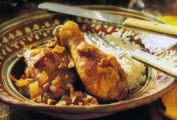 A decorative bowl with chicken braised with saffron, cinnamon, lavender, and almonds over rice