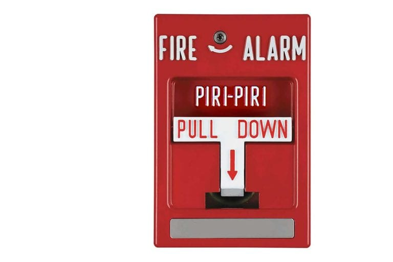 A fire alarm that says piri-piri on it