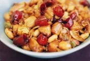 Bowl of chicken pieces, peanuts, chiles in an Authentic Chinese sauce of soy, sesame oil, black vinegar