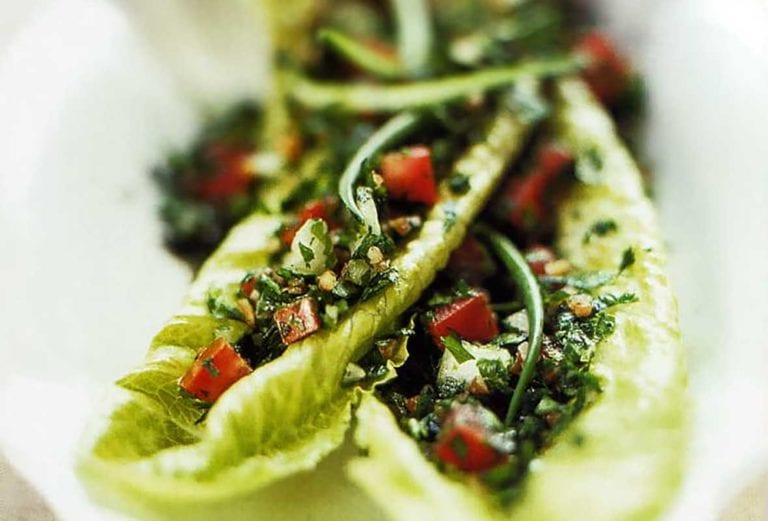 Two romaine leaves topped with a scoop of easy tabbouleh.