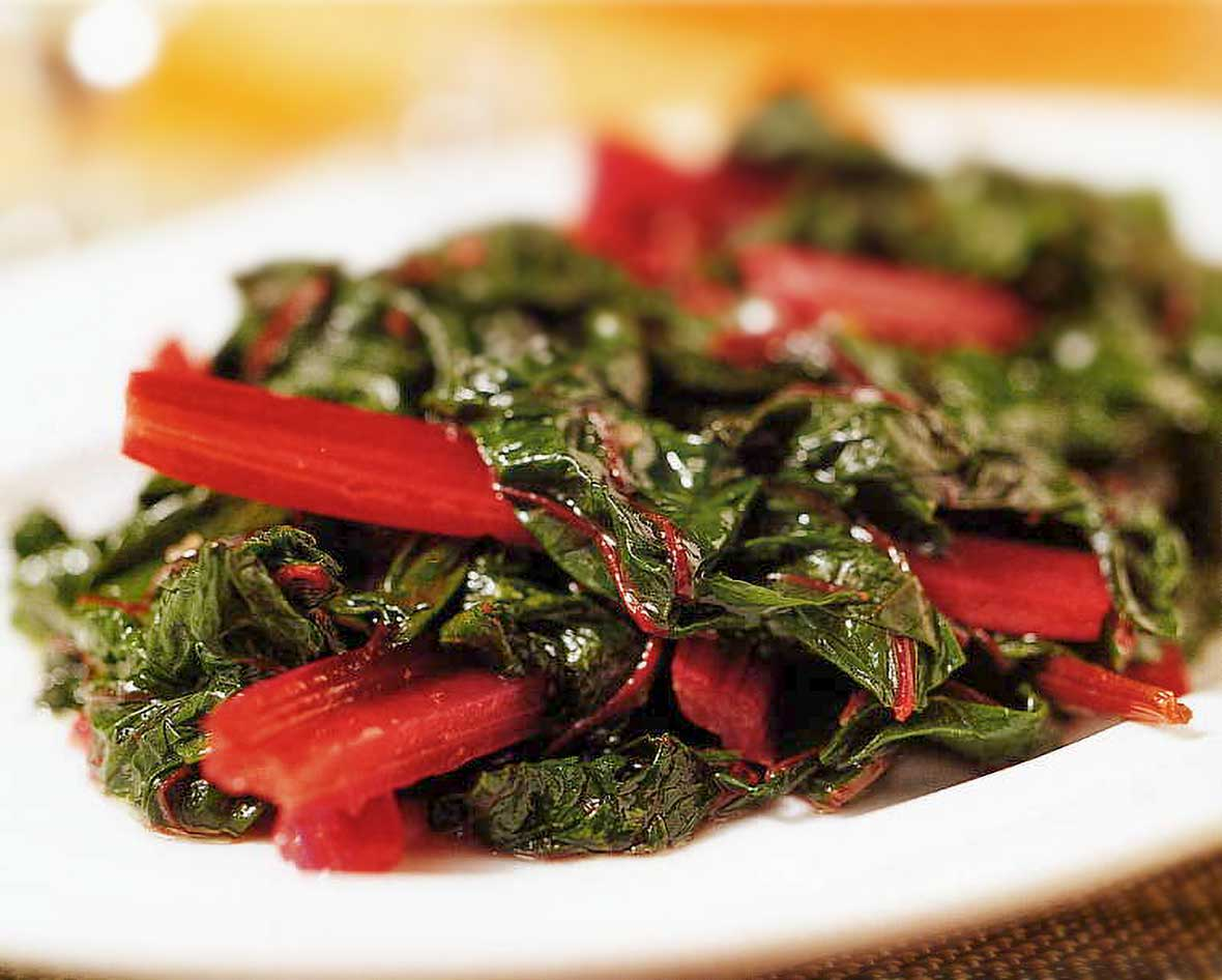 Plate of sauteed Swiss chard with red stems