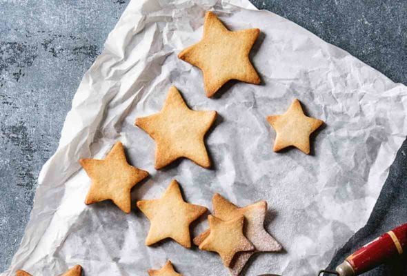 Star-shaped cookies on a piece of parchment paper