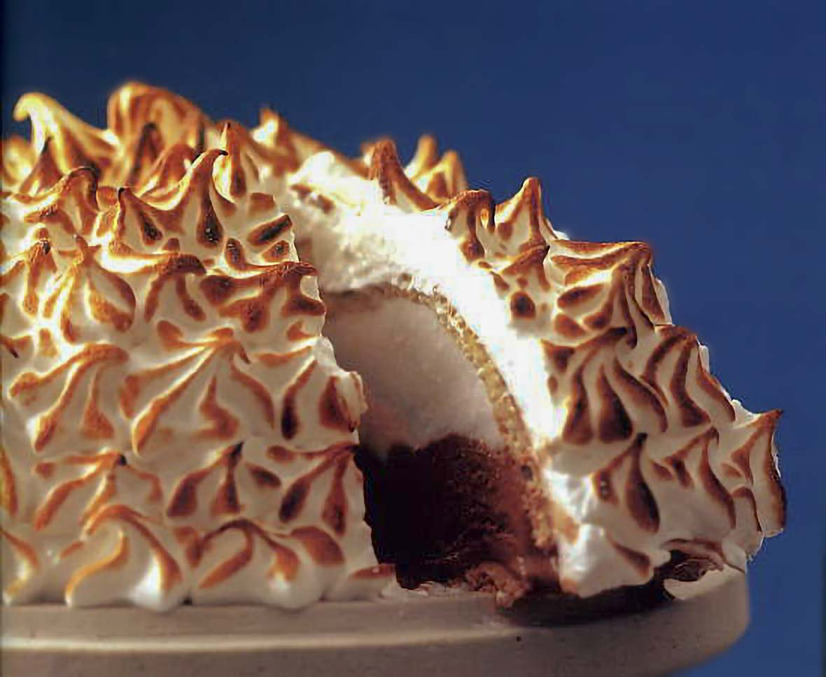 Baked Alaska--a dome of coconut sorbet and chocolate ice cream covered in meringue that has been browned