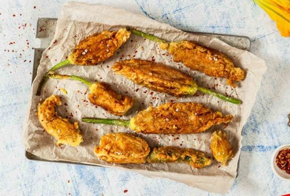 Tray of 8 deep-fried stuffed zucchini flowers, filled with ricotta cheese and herbs