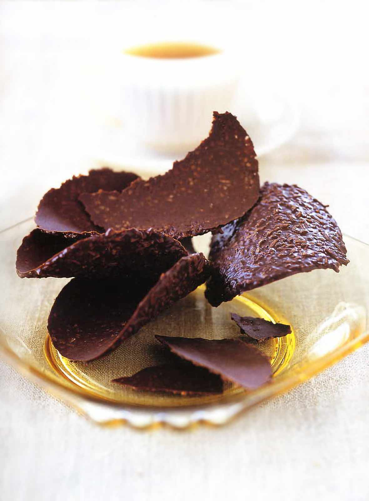 Yellow glass plate with 6 hazelnut chocolate tuiles--curved chocolate candies