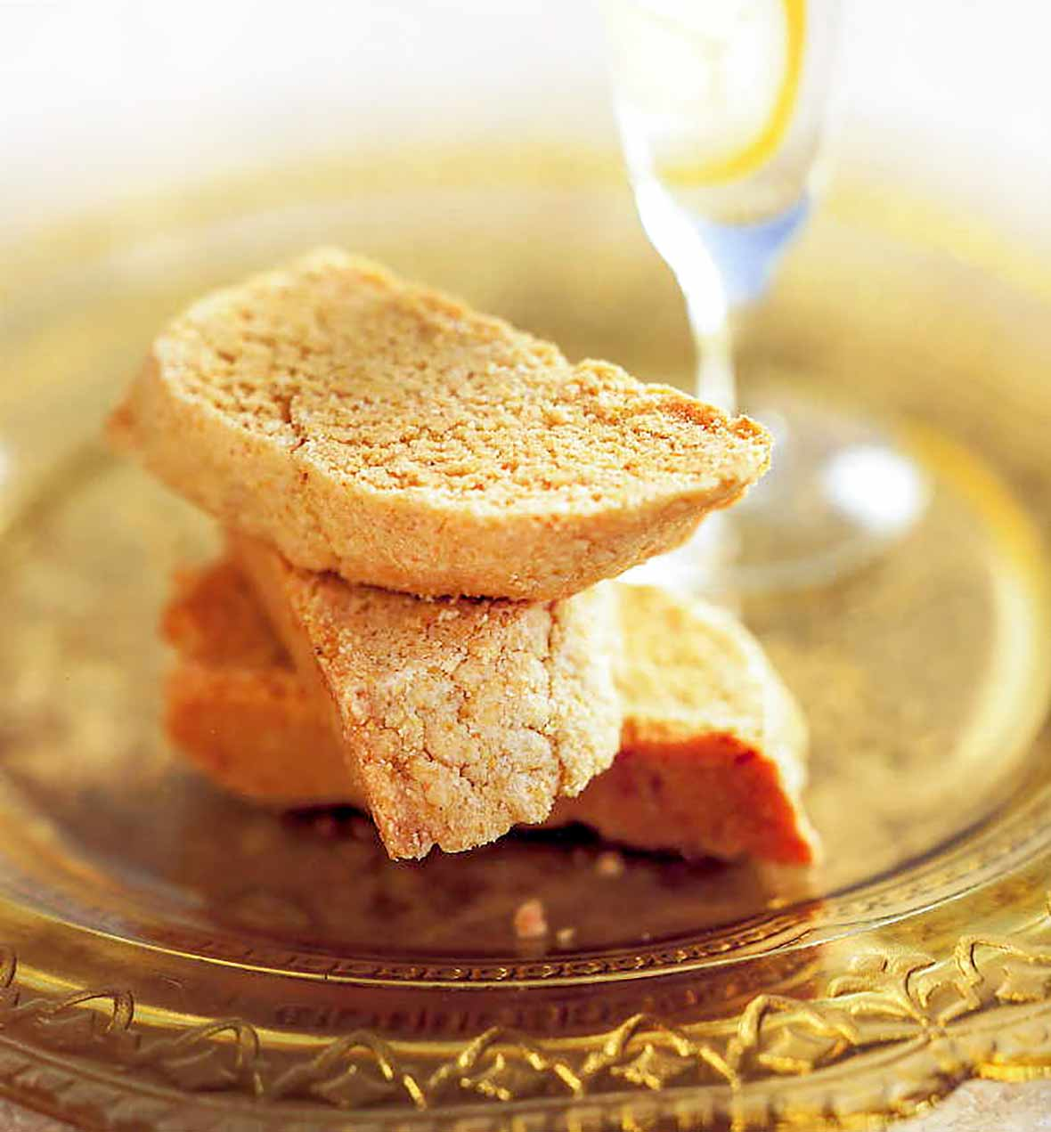 The half-moon biscotti cookies on a yellow glass plate