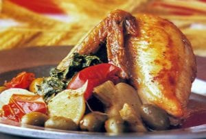 Half baked chicken With olives, turnips, and turnip greens on a plate