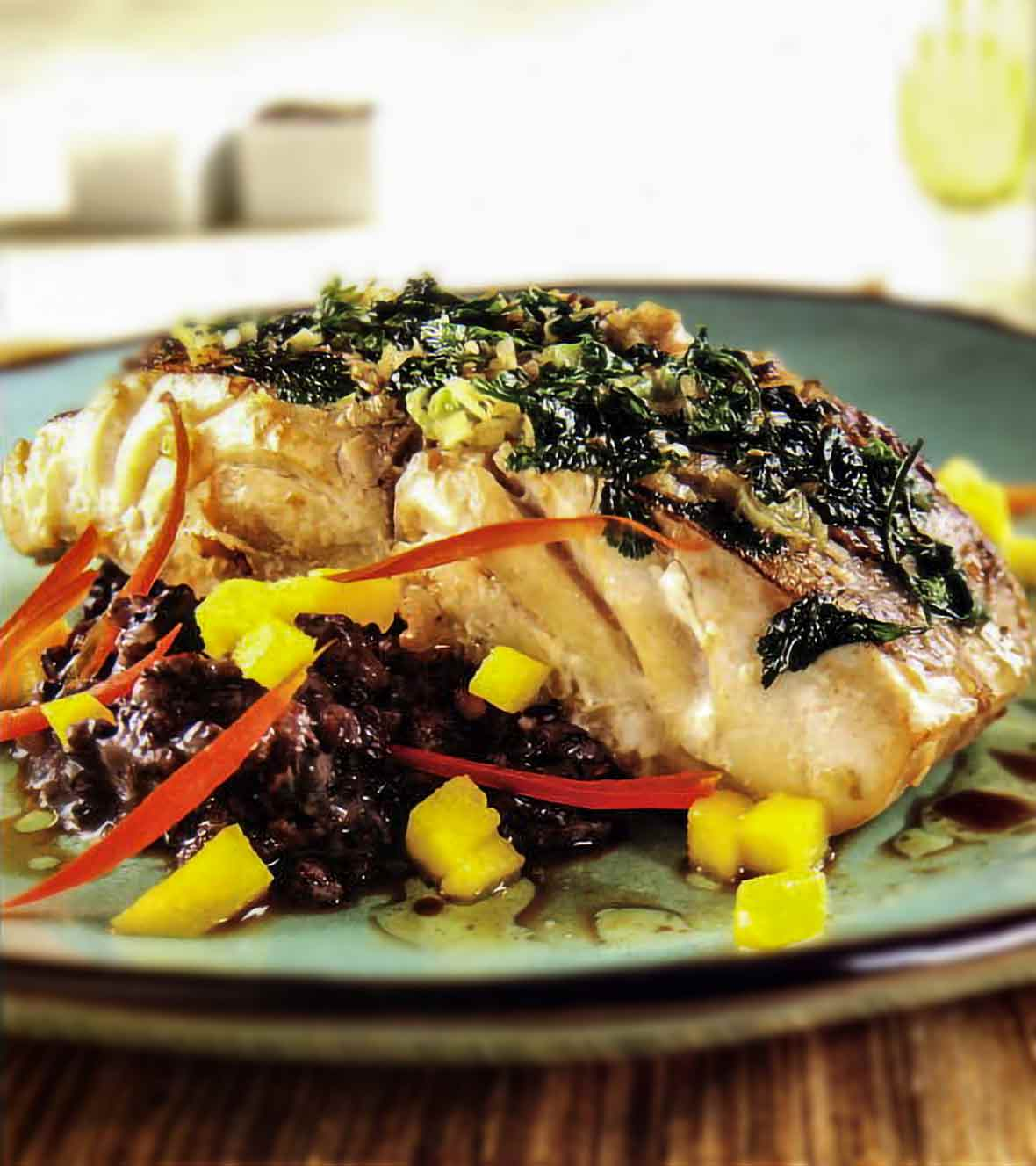 Ehu with a lemongrass-cilantro crust on a ned of black rice and diced mango