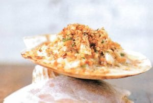 Baked seafood imperial--crab, shrimp, scallops, and calamari in a cream sauce, topped with bread crumbs and baked--on a water cracker