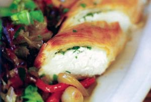 Goat cheese and herbs wrapped in a phyllo pastry log along side a red pepper salad