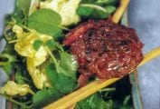 A spiced lamb burgers on a Vietnamese salad of watercress, scallions, mint, basil, cilantro