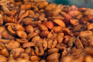 A bowl of dry-roasted chile peanuts.