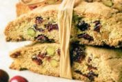 Several cranberry pistachio biscotti cookies tied together with raffia