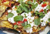 Baked eggplant topped with chiles, feta cheese and mint
