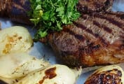New York Strip Steaks with Black Pepper, Onions, and Garlic