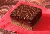 A raspberry-truffle brownie bar--layers of cocoa shortbread, raspberry brownie, and chocolate ganache swirled on top