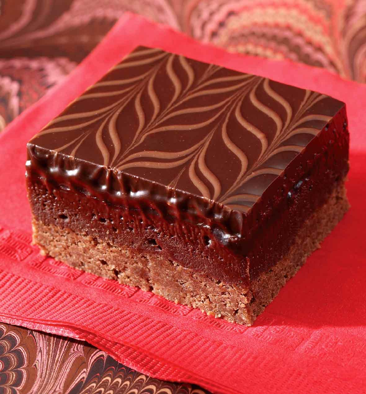 A raspberry-truffle brownie bar--layers of cocoa shortbread, raspberry brownie, and chocolate ganache swirled on top
