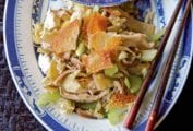 Plate of chicken shop suey with diced chicken breast, napa cabbage, bamboo shoots, celery, wonton wrappers, and rice