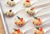 Spoons with smoked salmon mousse, blue cheese mousse, and cauliflower mousse in a baking sheet