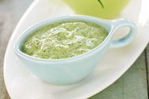 A light-blue gravy boat filled with svelte green goddess dip
