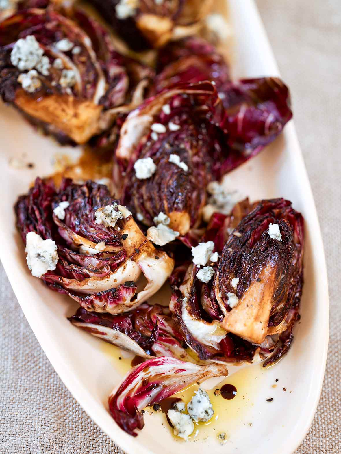 Oval plate with a grilled radicchio salad, Gorgonzola, and balsamic vinaigrette