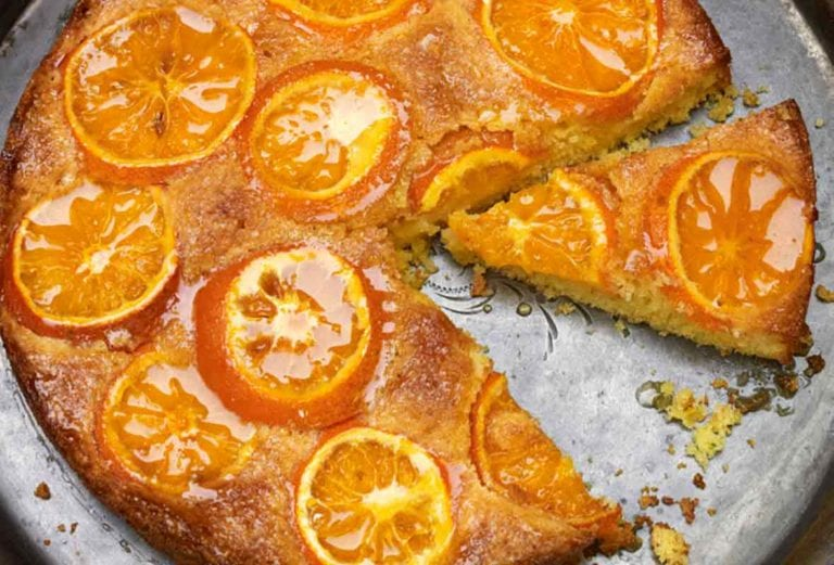 A cut satsuma orange cake in a round baking sheet