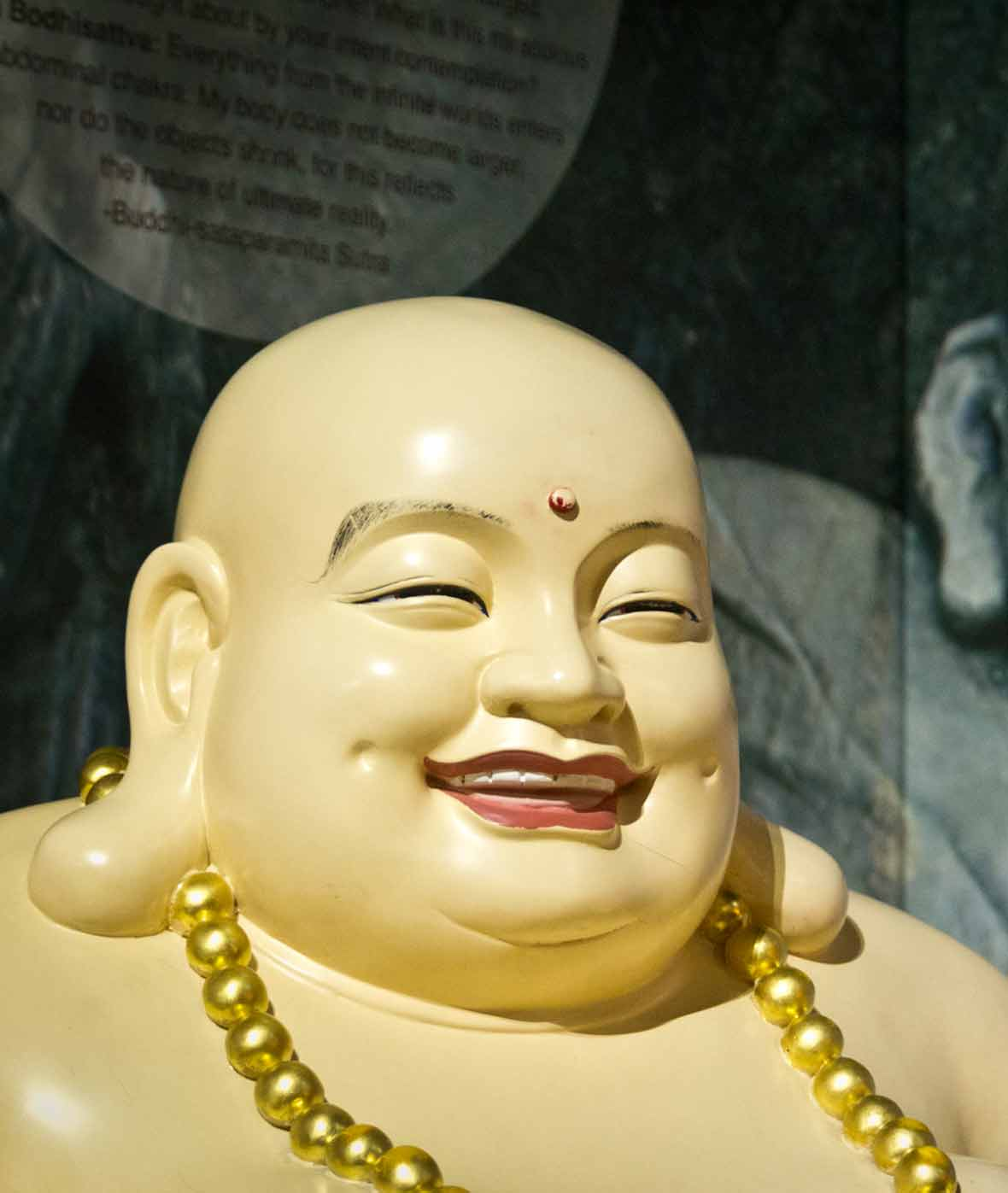 A statue of a fat smiling Buddha