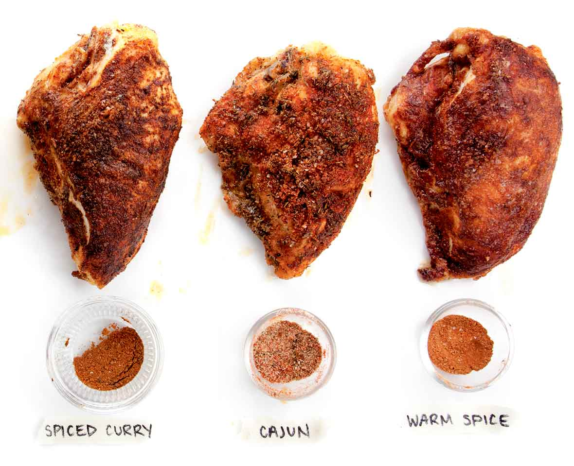 Three spiced roast chicken thighs, with warm spice, cajun, and spiced curry coatings
