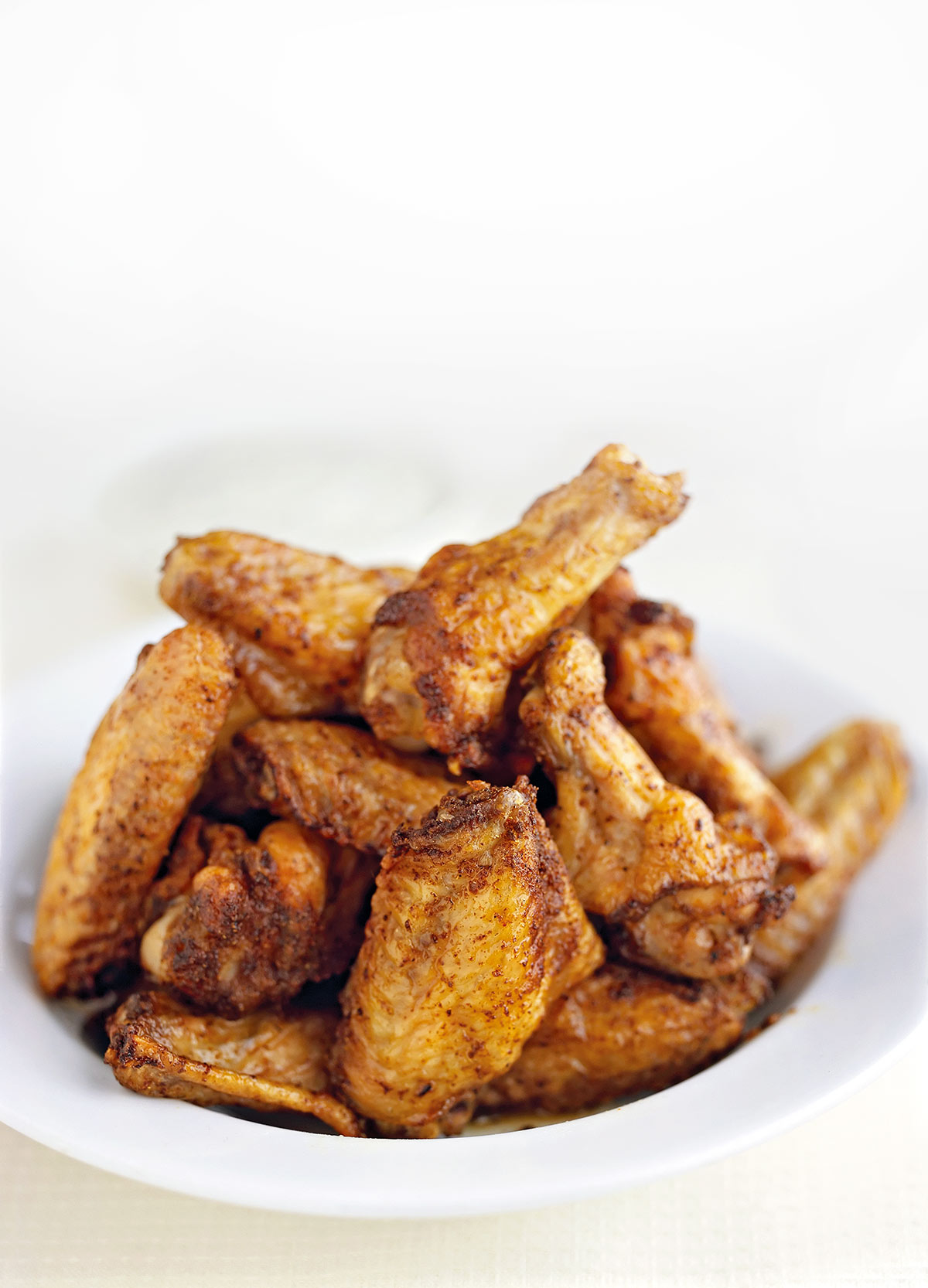 A bowl of Chinese five spice chicken wings.