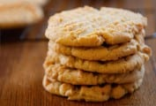 A stack of five old-fashioned peanut butter cookies, with crosshatch marks on top