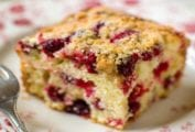 A square of cranberry buckle with a streusel top and studded with cranberries