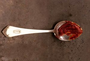 Silver spoon with a mound of Portuguese red pepper paste