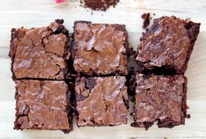 Six one-bowl mocha brownies on wood