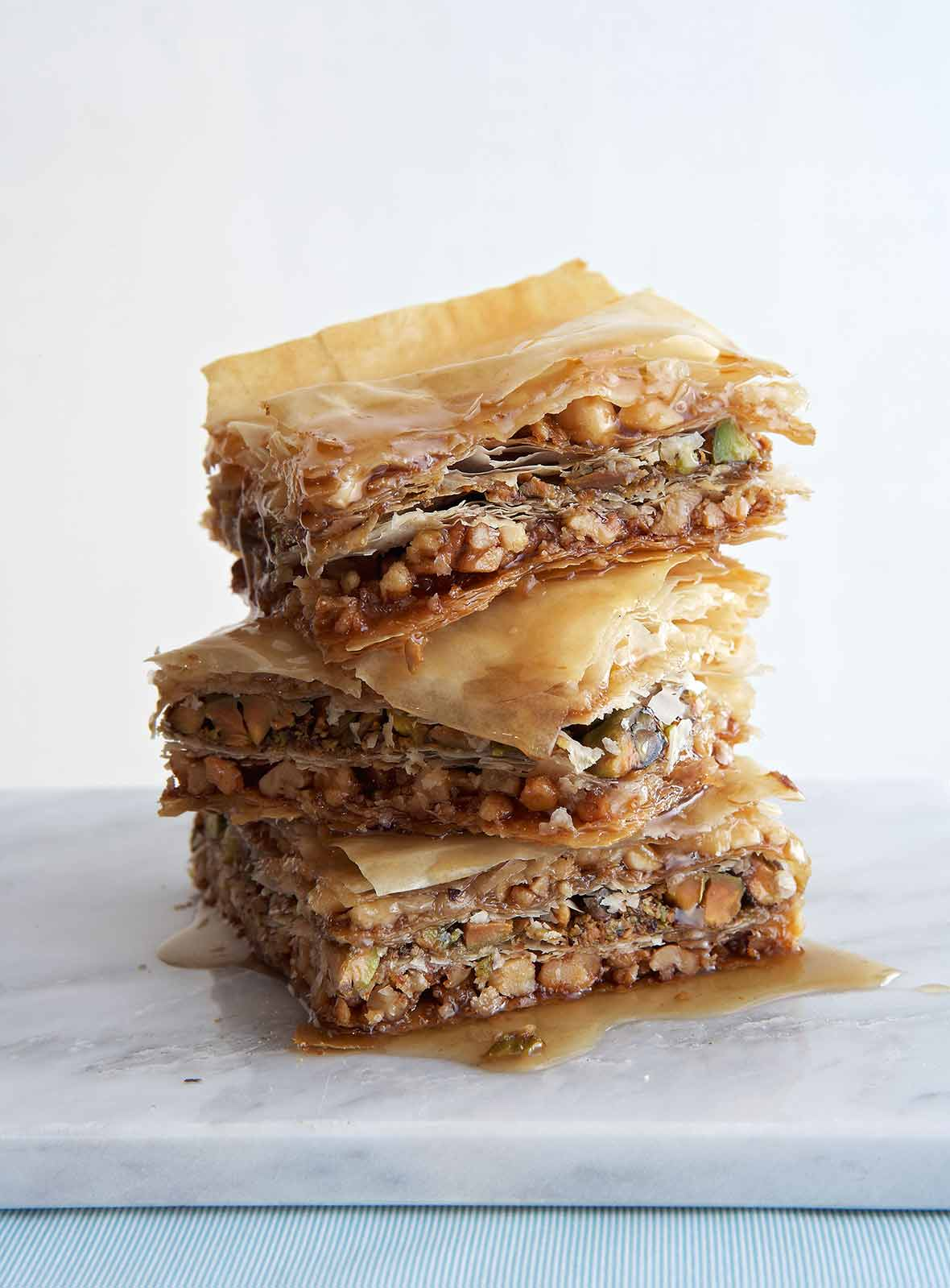 Three pieces of vegan baklava stacked on top of each other.