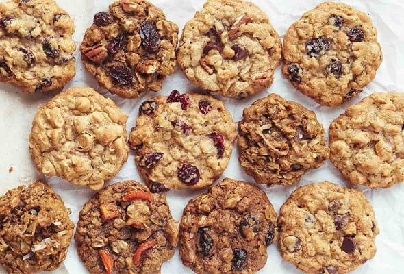 Twelve oatmeal cookies, each with varied fillings