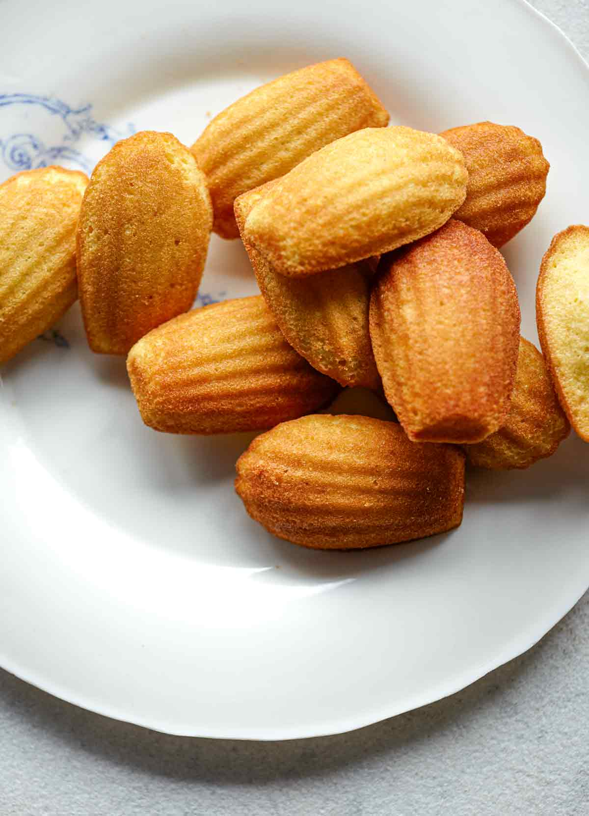 A white plate topped with classic madeleines.