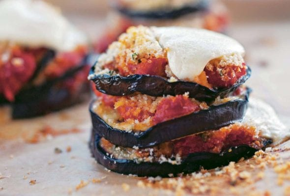 Grilled eggplant Parmesan made with stacks of eggplant slices topped with tomato sauce and mozzarella.