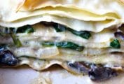 Layers of pasta with mushrooms, spinach, and bechamel sauce between each layer