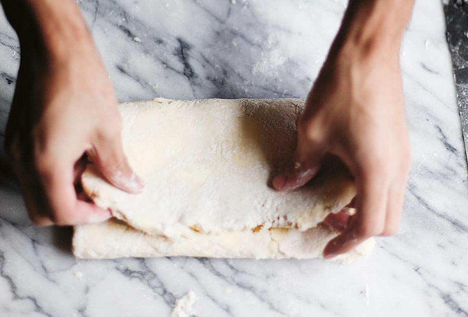 A piece of quick puff pastry being folded over.