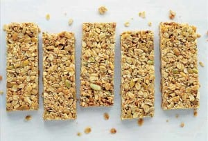 Five cinnamon granola bars on a white background.