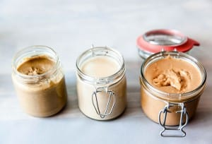 Three jars of different types of homemade nut butter.