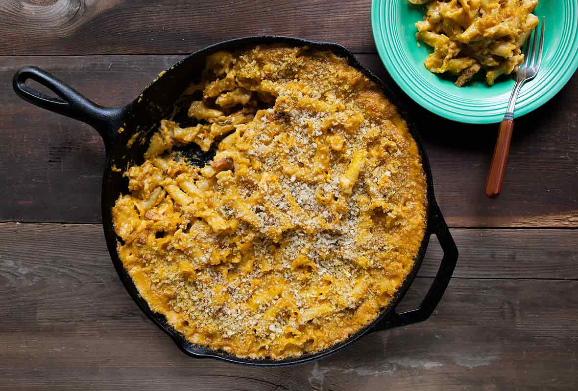 A cast-iron skillet filled with pumpkin mac and cheese