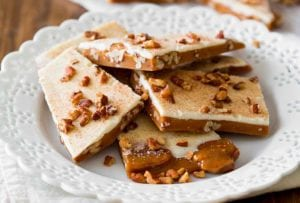 Plate of pumpkin spice toffee--made with toffee, pumpkin spice, white chocolate, and pecans