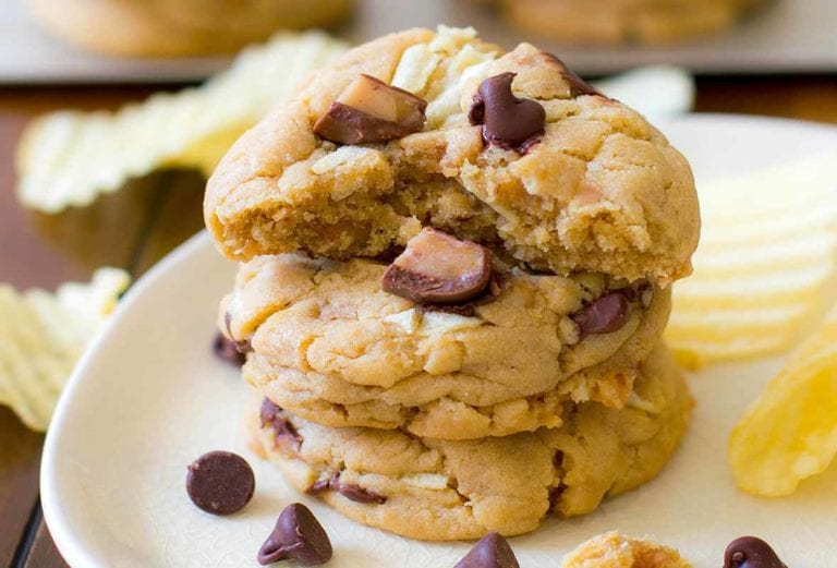A plate of chocolate chip cookies with with potato chips and toffee pieces baked in