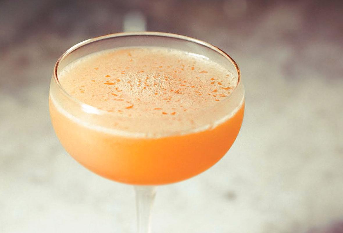 A flor de jerez cocktail in a coupe glass.