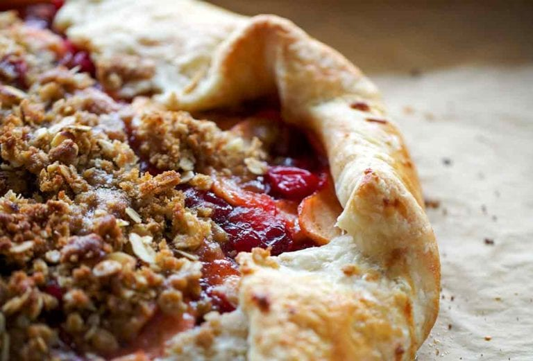 A cooked cranberry apple crostata on a piece of parchment.