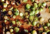 Crispy roasted Brussels sprouts on a rimmed baking sheet.