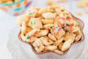 Two bowls of chex mix coated in funfetti